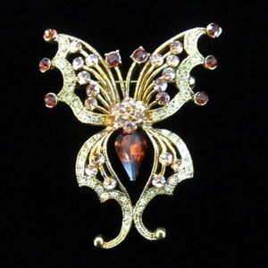 Amber rhinestone & gold tone butterfly brooch